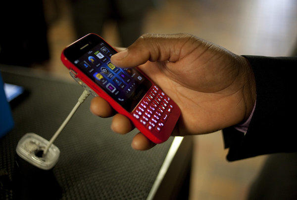 An attendee views the BlackBerry Q5 smartphone during the company's annual general meeting in Waterloo, Ontario.