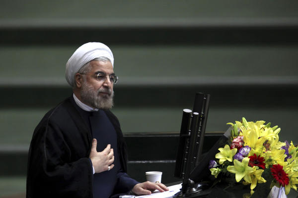Iranian President Hassan Rouhani, shown here addressing parliament last month, told NBC News on Wednesday that Iran will never develop nuclear weapons.