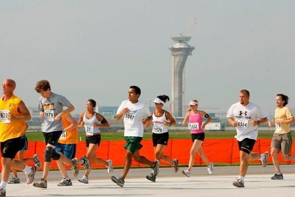 "Runners during the ""Athens Sister City Shuffle 5K on the Runway"" race on the tarmac of the then-new runway at Chicago's O'Hare Airport."