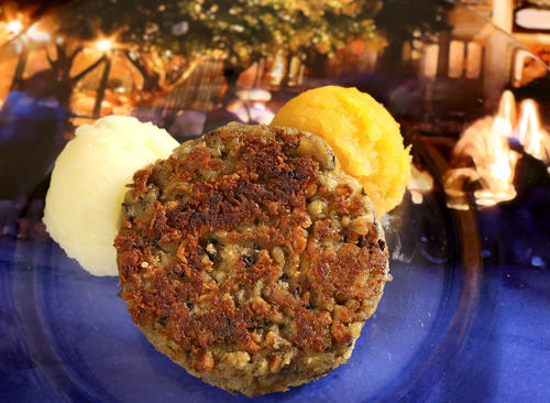 Vegetarian Haggis with Neeps and Tatties -- a Griddled Vegetable Cake with Rutabaga and Mashed Potatoes, from the new Scotland kiosk.
