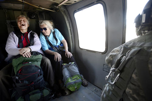 Two women smile after they were rescued by a helicopter crew with the 2-4 GSAB 4th Infantry Division. Colorado authorities coping with the aftermath of last week's deadly downpours stepped up the search for victims left stranded in the foothills of the Rockies and evacuations of prairie towns in danger of being swamped as the flood crest moved downstream.