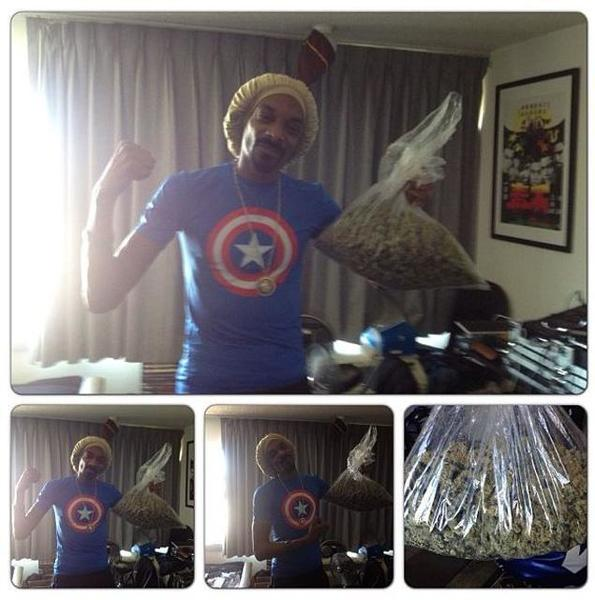 Snoop Lion poses with his winnings.