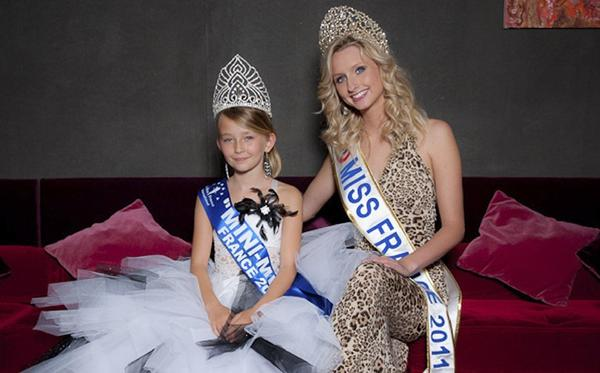 Oceane Scharre, 10, elected Mini Miss France 2011 (she's the one on the left, posing with an adult pageant winner) hardly looks like a threat to the well-being of French girls.