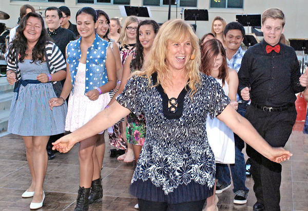 Dance instructor Linda Shoemake helped students, parents and supporters get up to speed with their salsa skills at last week's fundraiser.