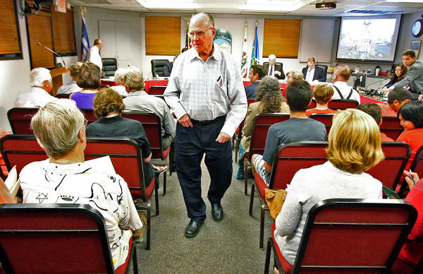 Rody Stephenson, of La Cañada, walks through council chambers at a La Cañada Flintridge council meeting where several citizens attended to speak on behalf of a ban on plastic bags on Monday, September 16, 2013. Stephenson is leading an initiative to ban plastic bags, or apply a $0.10 fee per bag use in the city.