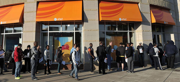 People line up outside the AT&T store in the 1000 block of Fleet Street to buy the iPhone 5 on the first day of sales last year.
