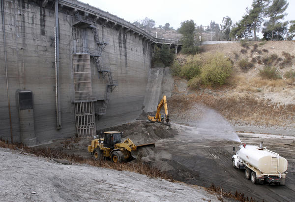 Los Angeles County Department of Public Works crews are removing about 4,000 cubic yards of dirt from the base of Devil's Gate Dam at Hahamongna Watershed Park in Pasadena on Wednesday, Sept. 18, 2013. It will take about one and a half weeks to complete the project.