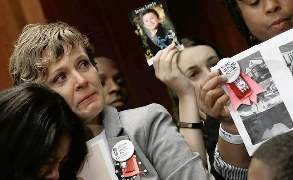 On the nine-month anniversary of the mass shooting at Sandy Hook Elementary School in Connecticut, members of Moms Demand Action attend a news conference at the U.S. Capitol to call for gun reform legislation.