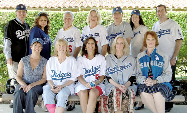 Hathaway-Sycamores board members at Dodger Stadium during last year's Celebrating Children event. This year's event is on September 27. Front: Elizabeth Hoxworth, Annsley Strong, Renee LaBran, Paulette Lang, Jan Hotchkin-Tinoco. Back row: Ken Goldstein, Lilia Villarreal, John Amato, Jennifer Leal Gowen, Scott Hodgkins, and Nancy Thomas, Tony Tartaglia.