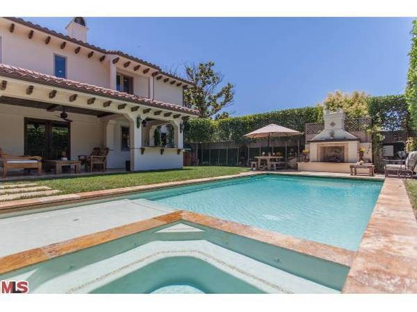 The backyard of the Studio City home sold by guitarist Billy Howerdel has a pool with a spa and an outdoor fireplace.