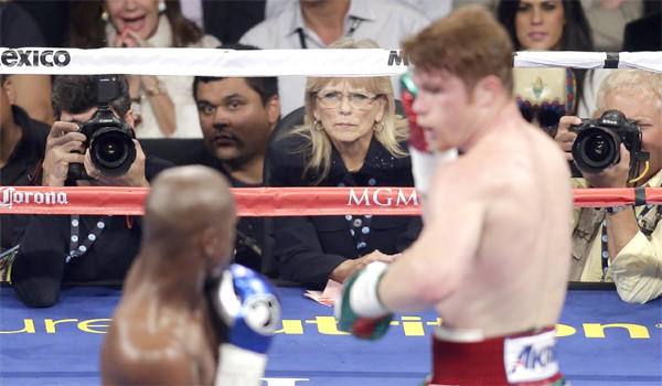 Cynthia Ross, center, who was one of three judges scoring the Floyd Mayweather Jr.-Saul 'Canelo' Alvarez fight, has decided to step away from boxing after taking harsh criticism for scoring the fight a draw.