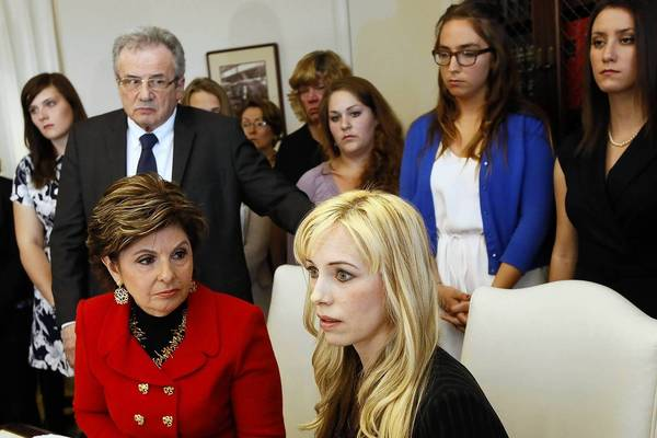 Attorney Gloria Allred, seated, left, with Occidental College professor Caroline Heldman and Occidental students and others at an April news conference where they announced the filing of a complaint against Occidental over the college's handling of sexual assault allegations.