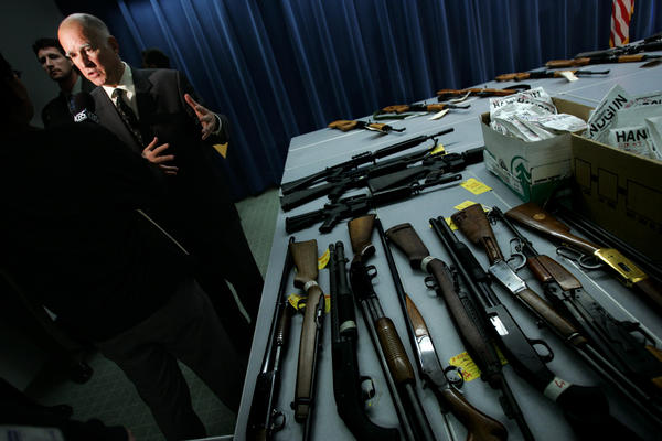 Then-California Atty. Gen. Jerry Brown, pictured in 2007 with guns his office had seized from those not eligible to possess them. Now, as governor, he is considering several gun control bills including a ban on lead bullets.