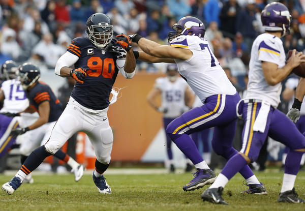 Julius Peppers applies the pass rush as the Vikings' Matt Kalil defends.