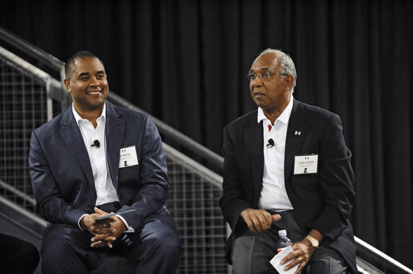Loyola men's basketball coach G.G. Smith and his father, Tubby Smith, who is the basketball coach at Texas Tech, introduced members of the Loyola basketball team to supporters at an event at the Under Armour Tide Point headquarters.