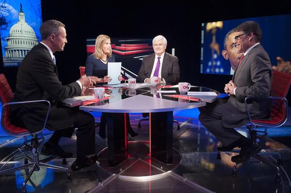 Maryland Governor Martin O'Malley, left, and Texas Governor Rick Perry, right, talk with Stephanie Cutter, center left, and Newt Gingrich, center right, during Crossfire.