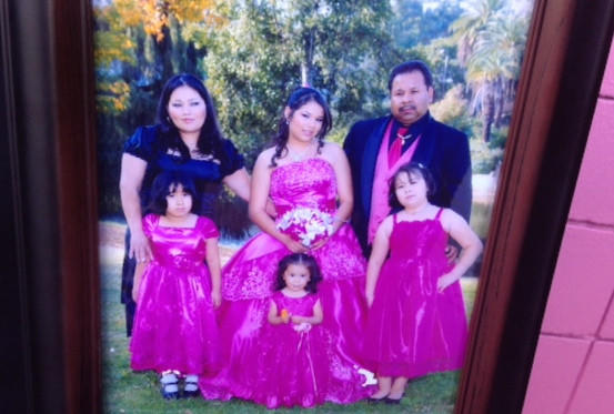 Martha Sanchez, left, with her husband and four of their children.