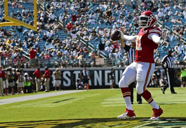 JACKSONVILLE, FL - SEPTEMBER 08: Tamba Hali #91 of the Kansas City Chiefs celebrates a touchdown during a game against the Jacksonville Jaguars at EverBank Field on September 8, 2013 in Jacksonville, Florida.