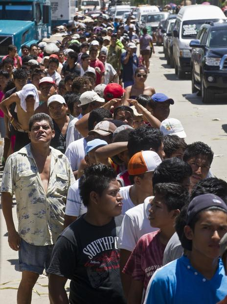 Residents line up for food in storm-stricken Acapulco.