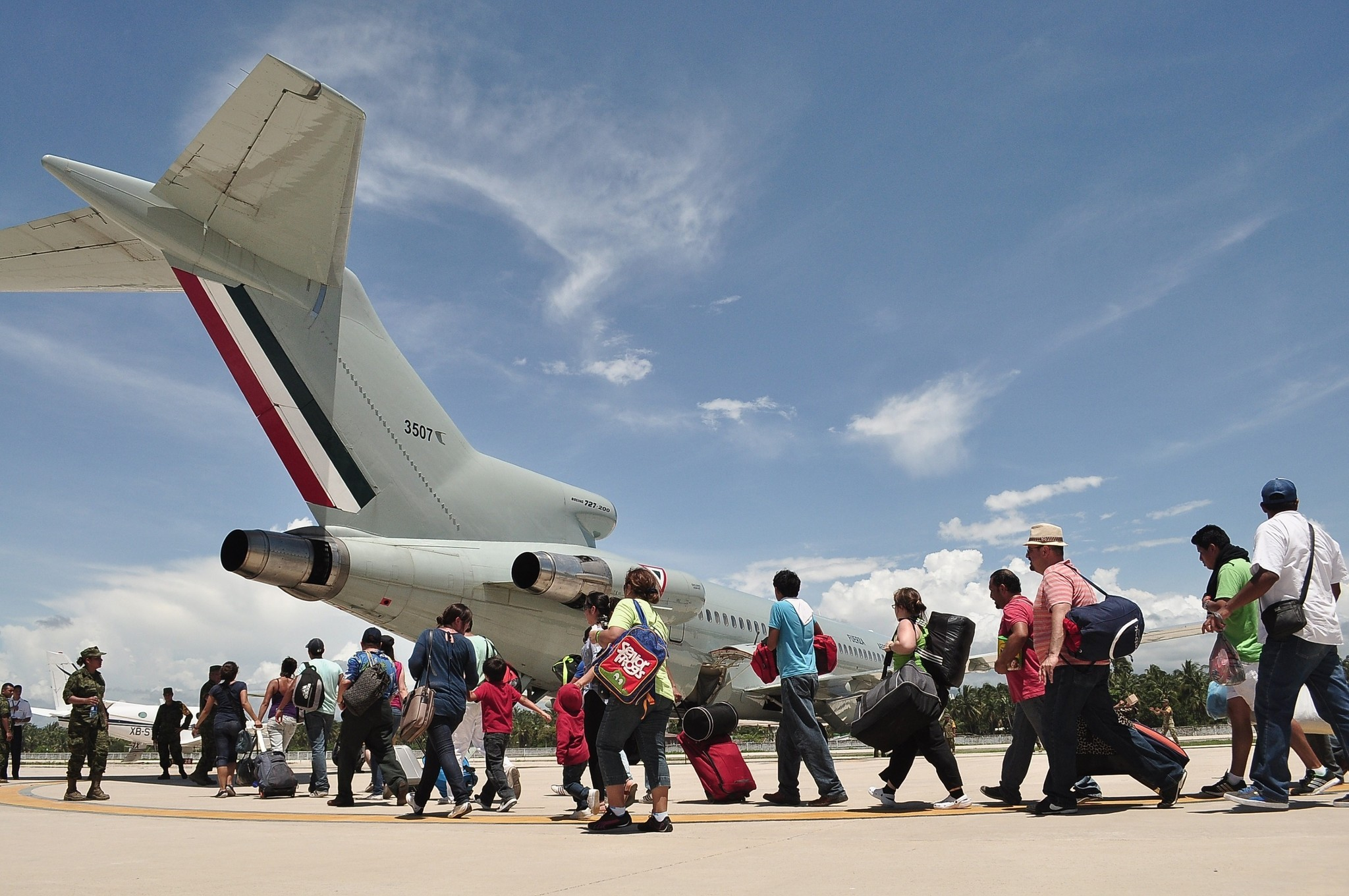 Flooding in Mexico - Tourists board a Mexican air force plane