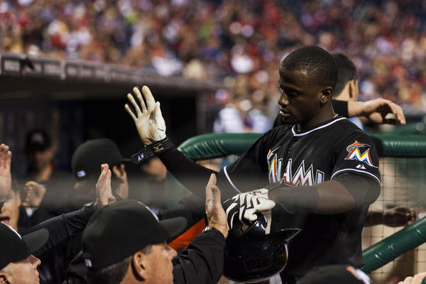 Sep 18, 2013; Philadelphia, PA, USA; Miami Marlins shortstop Adeiny Hechavarria (3) celebrates scoring with teammates during the fifth inning against the Philadelphia Phillies at Citizens Bank Park.