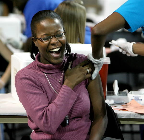 Nursing student Tesha Franklin reacts to getting her first-ever flu shot during a 2009 event at the University of Central Florida, where health workers tried to set a world record for the most vaccinations in an eight-hour period.