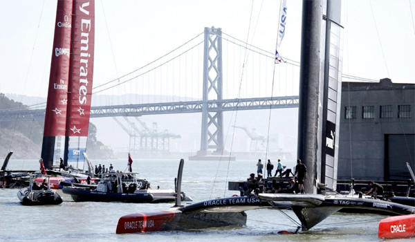 Team New Zealand, left, is one win away from victory over Team USA in the America's Cup finals after winning Race 11 on Wednesday before Race 12 was stopped because the wind exceeded the safety limit.