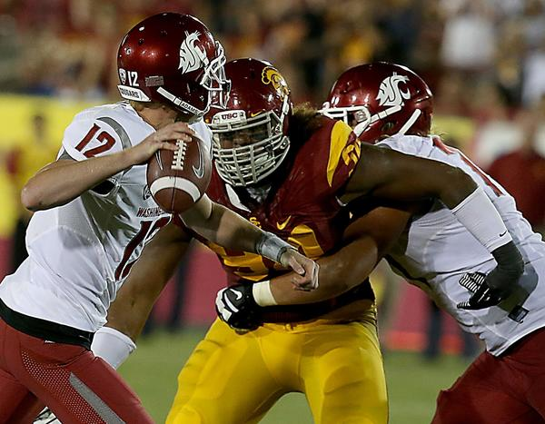 Leonard Williams, pressuring Washington State quarterback Connor Halliday earlier this season, and USC's defense has been tough to score against this season.