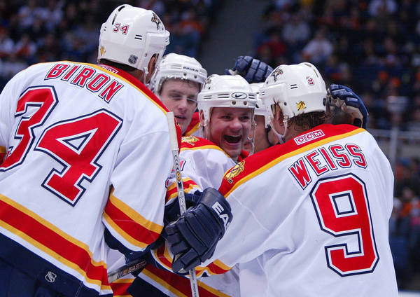 Missed playoffsCoaches: Mike Keenan, Rick Dudley, John TorchettiCaption: Byron Ritchie, middle, of the Florida Panthers smiles and celebrates with teammates after a goal scored by Stephen Weiss against Garth Snow of the New York Islanders.