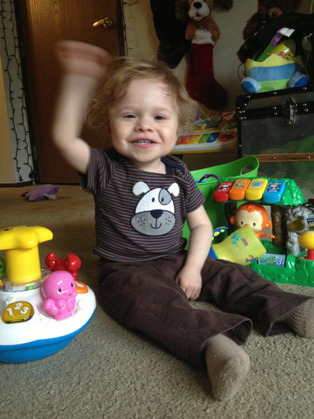 Zander Tewksbury, 2, smiles as he plays with his toys.