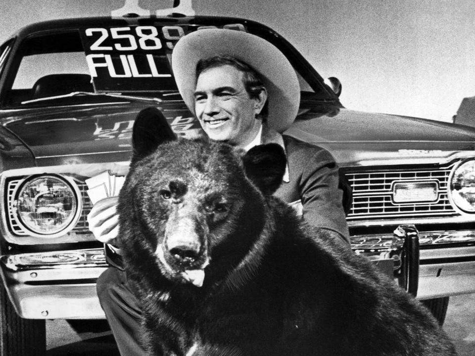 Cal Worthington is shown recording a car commercial.