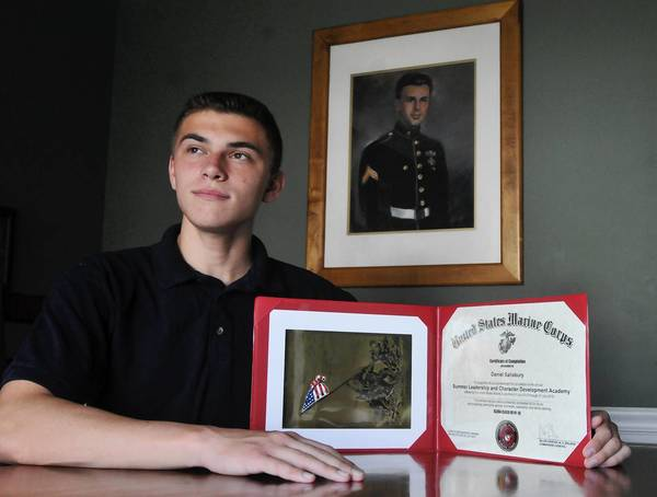 Enrico Fermi High School Senior Daniel Salisbury was one of 96 students across the country to be invited to the United States Marine Corps Summer Leadership and Character Development Academy in July. The portrait on the wall is of Salisbury's grandfather, of the same name, who fought as a Marine at Guadalcanal in WWII.