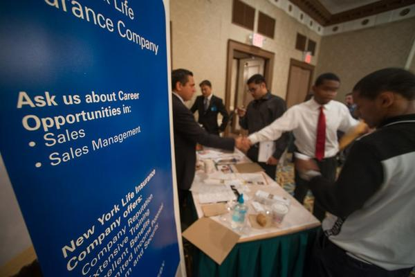 Job seekers meet recruiters during an employment fair in New York.