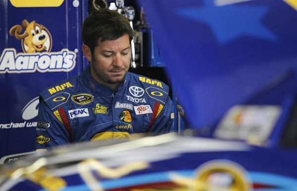 Martin Truex Jr. was one of three drivers from Michael Waltrip Racing penalized after at Richmond (Va.) International Raceway that determined which drivers would qualify for NASCAR's Chase for the Cup.