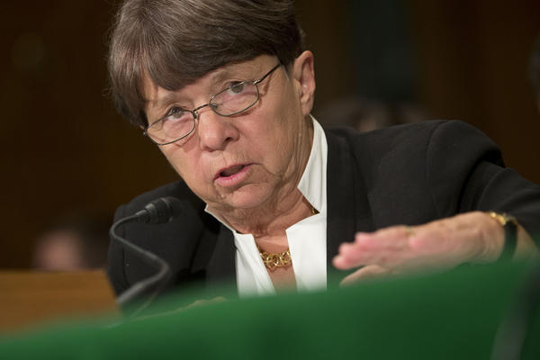 Mary Jo White, chairwoman of the U.S. Securities and Exchange Commission, listens during a Senate Banking Committee hearing in Washington, D.C., in July.