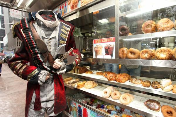 "The 7-foot-tall Headless Horseman gets breakfast during FOX's ""Sleepy Hollow - Fan Experience"" on Monday, Sept. 16, 2013 in New York."