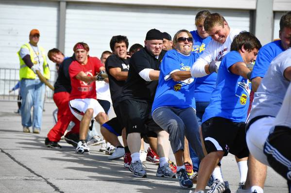 Park Ridge police personnel join Maine South High School football players in a plane-pulling competition in 2011 to raise money for Special Olympics Illinois.