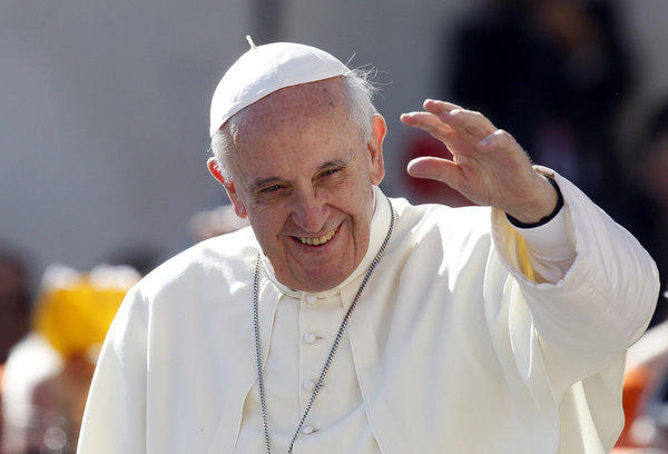 "Pope Francis waves to the faithful in St. Peter's Square at the Vatican on Wednesday. He said in an interview, ""We cannot insist only on issues related to abortion, gay marriage and the use of contraceptive methods."""