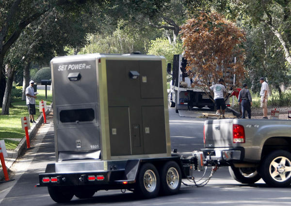 Film production crews arrive and begin unloading trees as other crews arrive with portable power at 4159 Commonwealth Ave., in La Cañada Flintridge on Wednesday, Sept. 18, 2013. Some neighbors do not like the frequency of filming at this home.