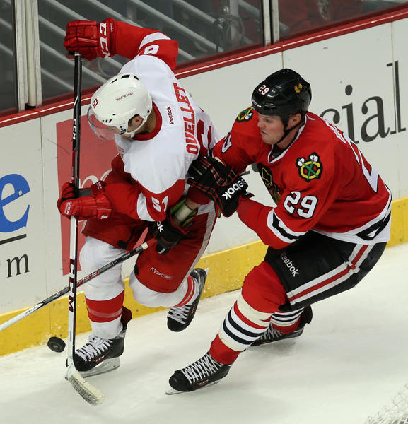 Winger Bryan Bickell (right) and his Blackhawks teammates are already back to defend the Stanley Cup.