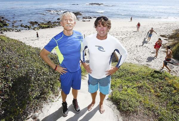 Laguna Niguel resident Rick Moore, left, and Nicholas Grisaffi of Laguna Beach helped a girl to shore who had her arm bitten off by a shark in Maui in August.