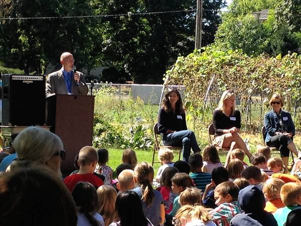 Ron Zeman, principal at Western Avenue School, speaks to the students at the dedication of the school's garden.