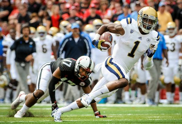 UCLA wide receiver Shaquelle Evans slips past Nebraska cornerback Ciante Evans on Sept. 14.