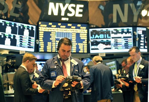 Traders on floor of New York Stock Exchange.