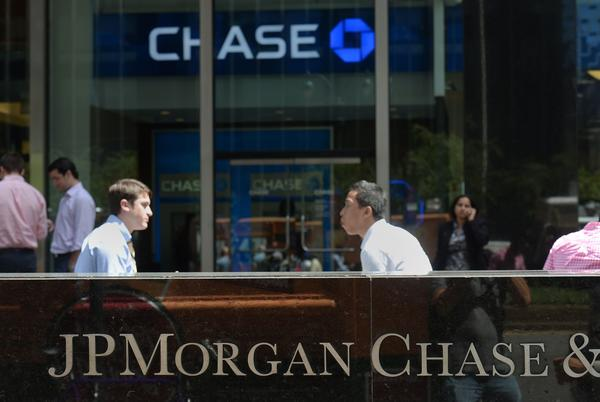 JPMorgan Chase & Co. has agreed to pay $389 million in refunds and penalties for illegally charging credit card customers for identity theft protection and other add-on services they didn't receive or authorize, federal regulators said.