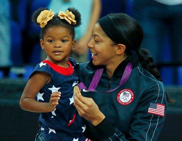 Candace Parker with her daughter, Laila, and the 2012 Olympic gold medal.