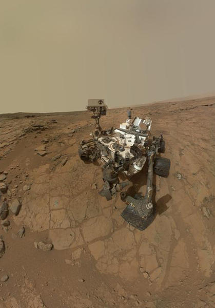 "This self-portrait of NASA's Mars rover Curiosity obtained May 22, 2013 combines dozens of exposures taken by the rover's Mars Hand Lens Imager (MAHLI) during the 177th Martian day, or sol, of Curiosity's work on Mars (February 3, 2013), plus three exposures taken during Sol 270 (May 10, 2013) to update the appearance of part of the ground beside the rover. The updated area, which is in the lower left quadrant of the image, shows gray-powder and two holes where Curiosity used its drill on the rock target ""John Klein."" The portion has been spliced into a self-portrait that was prepared and released in February (PIA16764), before the use of the drill. The result shows what the site where the self-portrait was taken looked like by the time the rover was ready to drive away from that site in May 2013. The rover's robotic arm is not visible in the mosaic. MAHLI, which took the component images for this mosaic, is mounted on a turret at the end of the arm. Wrist motions and turret rotations on the arm allowed MAHLI to acquire the mosaic's component images. The arm was positioned out of the shot in the images, or portions of images, used in the mosaic."