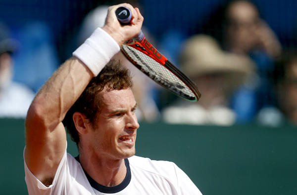Andy Murray returns a shot against Ivan Dodig during Davis Cup play on Sunday.