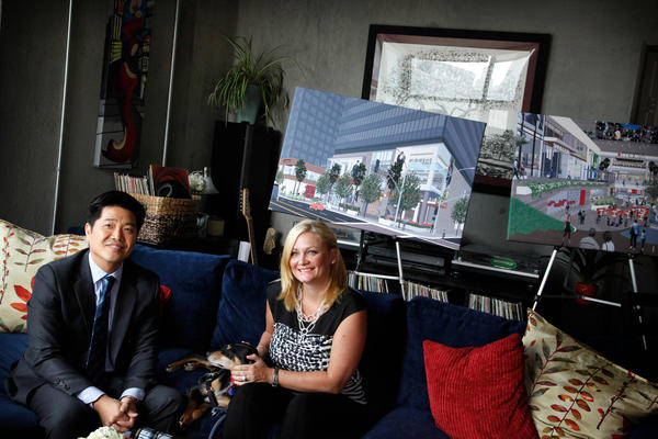 Architect Simon Ha and his wife, Nikki Olson-Ha, appear during a news conference in their loft apartment in downtown Los Angeles. They released a survey showing that more people, with more money, are moving into downtown.