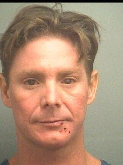 Charles Challinor, 35, of Jupiter, is accused of pulling a knife on staff at a Jupiter tiki bar, then fleeing by swimming away down the Loxahatchee River.